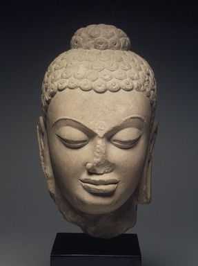 Head of Buddha, 5th century. Red sandstone, 11 3/4 x 7 1/2 x 7 in. (29.8 x 19.1 x 17.8 cm). Brooklyn Museum, Gift of Georgia and Michael de Havenon, 1998.178.4. Creative Commons-BY