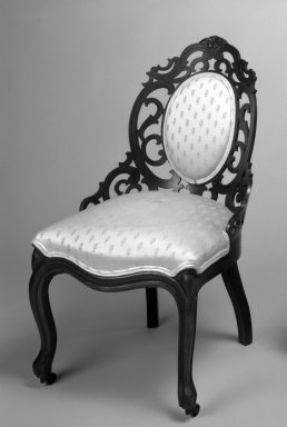John Henry Belter (American, born Germany, 1804-1863). Chair, ca. 1840-1850. Laminated wood with upholstered seats Brooklyn Museum, Bequest of Miriam Godofsky, 1999.105.1. Creative Commons-BY