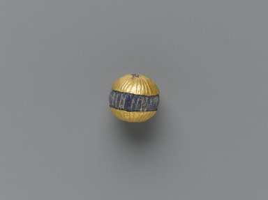 Sumerian. Pin Terminal, ca. 2600-2500 B.C.E. Gold, lapis lazuli, traces of silver, Diam. 7/8 in. (2.3 cm). Brooklyn Museum, Purchased with funds given by Shelby White, 1999.109.10. Creative Commons-BY