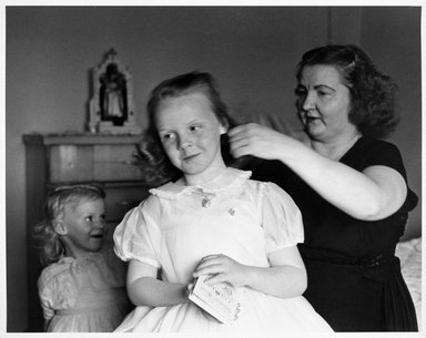 Larry Fink (American, born 1941). Confirmation Day (Mother and Two Daughters), ca. early 1960s. Gelatin silver photograph, image: 15 1/8 x 19 3/8 in. (38.4 x 49.2 cm). Brooklyn Museum, Gift of Joan Snyder, 1999.128.1. © Larry Fink