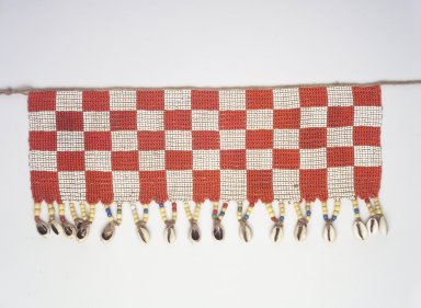 Kirdi. Beaded Apron, early 20th century. Colored glass beads, cotton, shells, 4 3/4 x 14 3/4 in.  (12.1 x 37.5 cm);. Brooklyn Museum, Gift of Mark S. Rapoport, M.D. and Jane C. Hughes, 1999.133.6. Creative Commons-BY