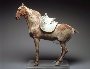 Figure of a Horse with Saddle, late 6th century. Earthenware, traces of pigment, 19 1/2 x 22 x 5 1/2 in. (49.5 x 56.0 x 14.0 cm). Brooklyn Museum, Gift of Peter W. Scheinman, 1999.138a-b. Creative Commons-BY