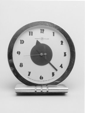 Gilbert Rohde (American, 1894-1944). Clock, Model 4706, ca. 1933. Painted and chrome-plated metal, glass, 6 3/8 x 6 x 2 3/4 in. (16.2 x 15.2 x 7 cm). Brooklyn Museum, Gift of Paul F. Walter, 1999.141.4. Creative Commons-BY