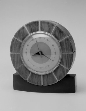 Howard Miller Clock Co. (founded 1926). Clock, ca. 1935. Metal, wood and glass, 6 3/4 x 6 x 1 7/8 in.  (17.1 x 15.2 x 4.8 cm). Brooklyn Museum, Gift of Paul F. Walter, 1999.141.7. Creative Commons-BY