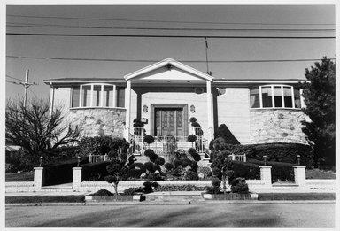 Edward Grazda (American, born 1947). House at Royce Avenue and Avenue V, Bergen Beach, Brooklyn, 1997. Gelatin silver photograph, sheet: 19 7/8 x 24 in.  (50.5 x 61.0 cm);. Brooklyn Museum, Robert A. Levinson Fund, 1999.64.1. © Edward Grazda