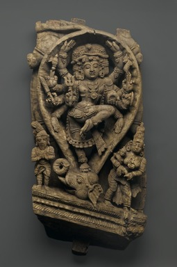 Relief Depicting Siva Dancing as the Slayer of Demons, late 16th-early 17th century. Wood, 30 x 14 in.  (76.2 x 35.6 cm). Brooklyn Museum, Gift of Dr. Bertram H. Schaffner, 1999.99.2