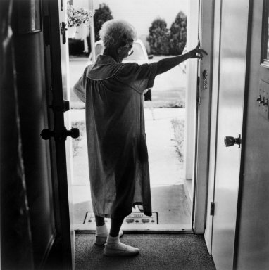 Gerard Vezzuso (American, born 1943). Woman at Door, Bayville, NJ, 2000. Gelatin silver photograph, sheet: 20 7/8 x 24 7/8 in.  (53.0 x 63.2 cm). Brooklyn Museum, Gift of the artist, 2000.122.3. © Gerard Vezzuso
