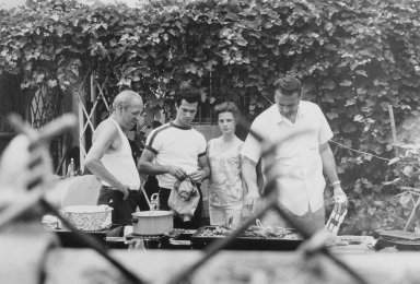 Gerard Vezzuso (American, born 1943). Four People at the Barbecue, Bay Ridge, Brooklyn, NY, 1971. Gelatin silver photograph, sheet: 20 7/8 x 24 7/8 in.  (53.0 x 63.2 cm). Brooklyn Museum, Gift of the artist, 2000.122.5. © Gerard Vezzuso
