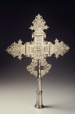 Amhara. Processional Cross, mid-20th century. Silver-plated metal alloy, 19 x 13 1/2 x 2 in.  (48.3 x 34.3 x 5.1 cm). Brooklyn Museum, Gift of Eric Goode, 2000.123.1. Creative Commons-BY