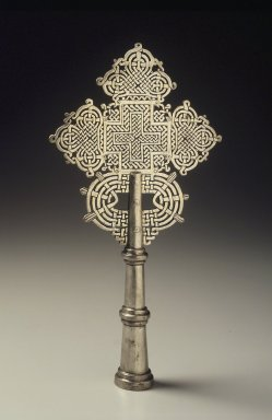 Amhara. Processional Cross, mid 20th century. Silver-plated metal alloy, 12 x 6 x 1 3/8 in.  (30.5 x 15.2 x 3.5 cm). Brooklyn Museum, Gift of Eric Goode, 2000.123.2. Creative Commons-BY