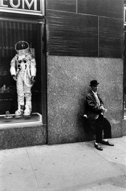 Joel Meyerowitz (American, born 1938). Rockefeller Center (Man and Astronaut Suit), 1970. Gelatin silver photograph, Sheet: 14 x 11 in. (35.6 x 27.9 cm). Brooklyn Museum, Gift of Julian and Elaine Hyman, 2000.132.10. © Joel Meyerowitz