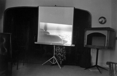 Joel Meyerowitz (American, born 1938). New Jersey Interior  (Airplane on Screen), 1965. Gelatin silver photograph, Sheet: 11 x 14 in. (27.9 x 35.6 cm). Brooklyn Museum, Gift of Julian and Elaine Hyman, 2000.132.3. © Joel Meyerowitz