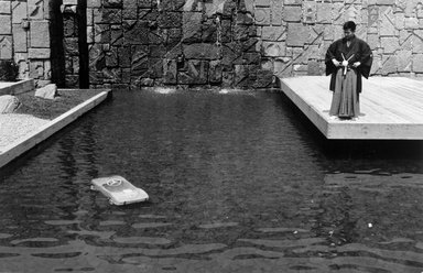 Joel Meyerowitz (American, born 1938). World's Fair, NYC (Man Looking at Car in Pool), 1964. Gelatin silver photograph, Sheet: 11 x 14 in. (27.9 x 35.6 cm). Brooklyn Museum, Gift of Julian and Elaine Hyman, 2000.132.4. © Joel Meyerowitz