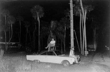 Joel Meyerowitz (American, born 1938). Cape Canaveral, Moon Launch (Couple Sitting on Car), 1968. Gelatin silver photograph, Sheet: 11 x 14 in. (27.9 x 35.6 cm). Brooklyn Museum, Gift of Julian and Elaine Hyman, 2000.132.7. © Joel Meyerowitz