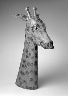 American. Giraffe Head, 1850-1900. Painted wood, glass (possibly), 26 x 11 x 13 in.  (66.0 x 27.9 x 33.0 cm). Brooklyn Museum, Gift of The Guennol Collection, 2000.48. Creative Commons-BY