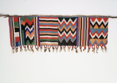 Kirdi. Pubic Apron, mid 20th century. Glass beads, cotton, cowrie shells, 6 1/2 x 17 1/2 in.  (16.5 x 44.5 cm). Brooklyn Museum, Gift of Mark S. Rapoport, M.D. and Jane C. Hughes, 2000.69.13. Creative Commons-BY