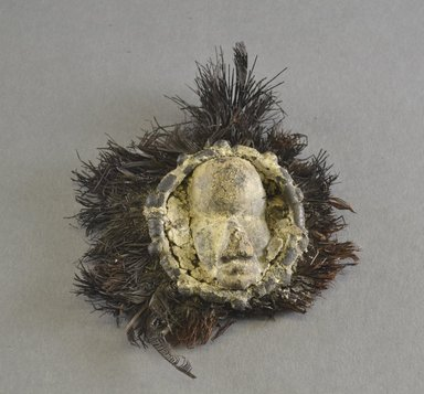 Dan. Miniature Mask, early 20th century. Wood, copper alloy, feathers, fiber, including feathers: 4 1/4 x 4 3/8 x 1 1/4 in.  (10.8 x 11.1 x 3.2 cm). Brooklyn Museum, Gift of Blake Robinson, 2000.70.6. Creative Commons-BY