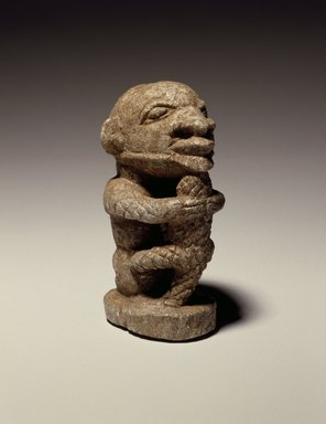 Sapi. Figure of a Man Holding a Crocodile, 15th century or earlier. Stone, 4 x 1 1/2 x 2 1/4 in.  (10.2 x 3.8 x 5.7 cm). Brooklyn Museum, Purchased with funds given by the Noah-Sadie K. Wachtel Foundation, Inc., 2000.93.1. Creative Commons-BY