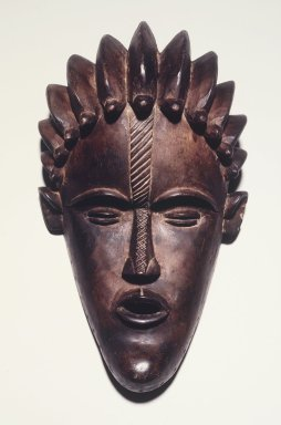 Gbi. Face Mask, early 20th century. Wood, 10 3/4 x 6 3/4 x 4 1/4 in.  (27.3 x 17.1 x 10.8 cm). Brooklyn Museum, Frank L. Babbott Fund, 2000.93.2. Creative Commons-BY