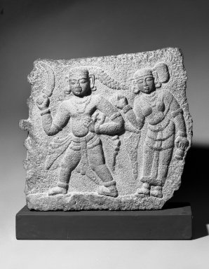 Relief of a Warrior with Attendant, 17th century. Granite, 23 1/2 x 27 in.  (59.7 x 68.6 cm). Brooklyn Museum, Gift of Dr. Alvin E. Friedman-Kien, 2002.119.1. Creative Commons-BY
