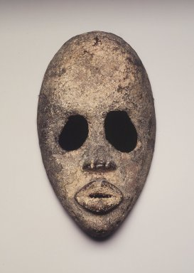 Dan. Mask, 19th century. Wood, metal, sacrificial materials (blood, macerated kola nut, palm oil?), 8 1/2 x 5 x 2 1/2 in.  (21.6 x 12.7 x 6.4 cm). Brooklyn Museum, Gift of Blake Robinson, 2002.31.1. Creative Commons-BY