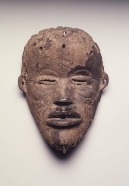 Mano. Tankagle Mask, 19th century. Wood, metal, 9 x 6 1/2 x 2 1/2 in.  (22.9 x 16.5 x 6.4 cm). Brooklyn Museum, Gift of Blake Robinson, 2002.31.2. Creative Commons-BY