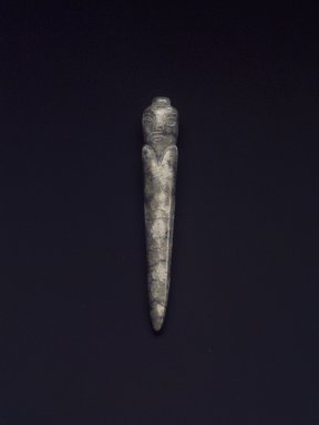 Conical Burial Plug in Stylized Human Form, 20th century. Nephrite, 2 x 3/8 in. (5.1 x 1 cm). Brooklyn Museum, Gift of Mr. and Mrs. Raymond Hargreaves, 2002.36.5. Creative Commons-BY