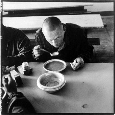 John Ranard (American, born 1952). Omsk Prison Colony, Omsk, Russia 2001, Prisoner with Bowl of Soup, 2001. Gelatin silver photograph, Sheet: 13 15/16 x 11 in. (35.4 x 27.9 cm). Brooklyn Museum, Gift of the artist, 2002.57.1. © John Ranard
