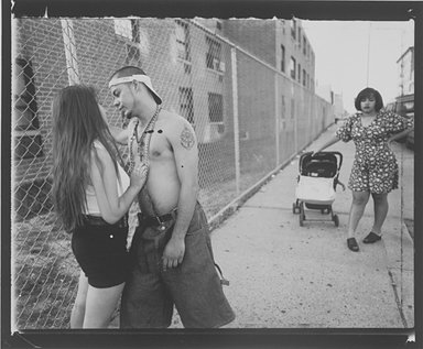 Vincent Cianni (American, born 1952). Anthony Hitting On Giselle, Vivien Waiting, Lorimer Street, Williamsburg, Brooklyn, The Southside, 1996. Gelatin silver photograph, Sheet: 11 x 14 in. (27.9 x 35.6 cm). Brooklyn Museum, Gift of Mary Cianni, 2003.18.1. © Vincent Cianni