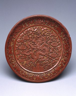 Dish Depicting a Dragon Amongst Foliage, 1522-1566. Carved cinnabar lacquer on wood, diameter: 7 3/8 in. (18.7 cm). Brooklyn Museum, Gift of Patricia Falk, from the Collection of Pauline B. and Myron S. Falk, Jr., 2003.30. Creative Commons-BY
