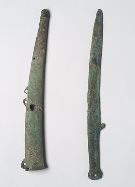 Dagger and Sheath, 7th-6th century B.C.E. Bronze, Dagger (a): 13 x 5 1/16 x 1/4 in. (33 x 12.9 x 0.6 cm). Brooklyn Museum, Anonymous gift, 2003.82.2a-b. Creative Commons-BY