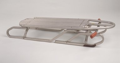 "Bertram Lesser (American, born 1924). ""Racer"" Sled, patented March 30, 1965. Aluminum, rubber, other metals, 7 1/8 x 43 x 25 in. (18.1 x 109.2 x 63.5 cm). Brooklyn Museum, Gift of M. Christmann Zulli and David J. Ramsay, 2003.86. Creative Commons-BY"