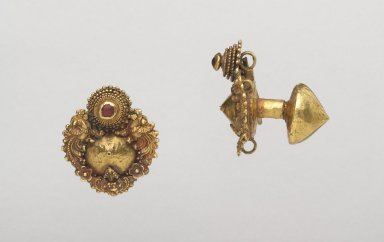 Pair of Earrings. Gold, 1 9/16 x 1 3/8 x 13/16 in. (4.0 x 3.5 x 2.0 cm). Brooklyn Museum, Gift of Dr. Alvin E. Friedman-Kien, 2004.112.37a-b. Creative Commons-BY