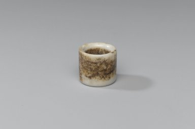 Circular Archer's Ring, 20th century. Jade, mottled, 1 x 1 1/8 x 3/4 in. (2.5 x 2.9 x 1.9 cm). Brooklyn Museum, Gift of Dr. Alvin E. Friedman-Kien, 2004.112.5. Creative Commons-BY