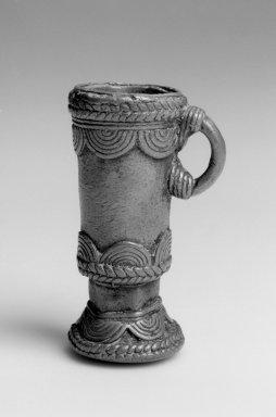 Dan. Snuff Mortar, 19th century. Copper alloy , 3 x 1 7/8 x 1 7/8 in. (7.6 x 4.8 x 4.8 cm). Brooklyn Museum, Gift of Blake Robinson, 2004.52.8. Creative Commons-BY