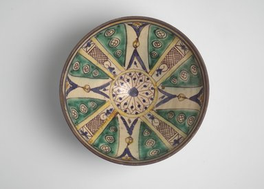 Bowl with Twelve-Pointed Central Star, 19th century. Earthenware with green, yellow, blue, brown and white glazes, Diam: 11 3/4 in. (29.8 cm); H. 5 in. Brooklyn Museum, Gift of Dr. Charles S. Grippi in honor of the memory of the late Professor Virgil H. Bird, 2004.83.2. Creative Commons-BY