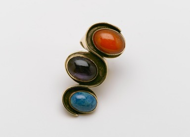Art Smith (American, 1917-1982). Undulation Ring, ca. 1961. Gold, chrysocola, amethyst, carnelian, 1 1/4 x 2 3/8 x 1 1/8 in. (3.2 x 6 x 2.9 cm). Brooklyn Museum, Gift of Charles L. Russell, 2007.61.12. Creative Commons-BY