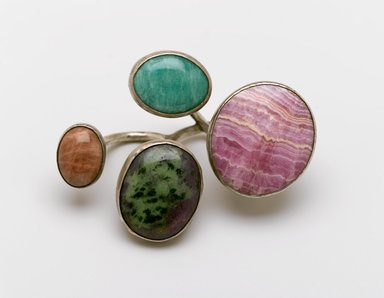 Art Smith (American, 1917-1982). Cluster Knuckles Ring, ca. 1968. Silver alloy, rhodochrosite, jade (?), turquoise (?), zoisite (?), 1 1/2 x 3 1/2 x 2 1/2 in. (3.8 x 8.9 x 6.4 cm). Brooklyn Museum, Gift of Charles L. Russell, 2007.61.17. Creative Commons-BY