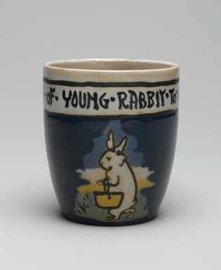 "AM. Mug, ""It is the Habit of Young Rabbit to go to School,"" 1917. Glazed earthenware, Height: 3 5/8 in. (9.2 cm). Brooklyn Museum, Gift of Joseph F. McCrindle in memory of J. Fuller Feder, by exchange, 2007.7.3. Creative Commons-BY"