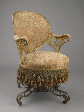 Thomas E. Warren (American, born 1808). Centripital Spring Chair, ca. 1849-1858. Cast iron, wood, modern upholstery, modern trim, original fringe, 34 1/4 x 23 1/2 x 28 1/4 in. (87 x 59.7 x 71.8 cm). Brooklyn Museum, Designated Purchase Fund, 2009.27. Creative Commons-BY