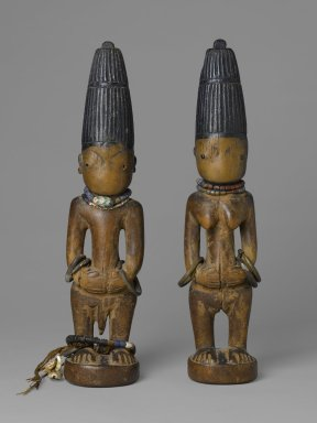 Yoruba. Pair of Twin Figures (Ere Ibeji), late 19th-early 20th century. Wood, pigment, beads, metal, cowrie shells, a: 12 x 2 1/2 x 2 1/2 in. (30.5 x 6.4 x 6.4 cm). Brooklyn Museum, Gift of the Coltrera Collection, 2010.22.1a-b. Creative Commons-BY