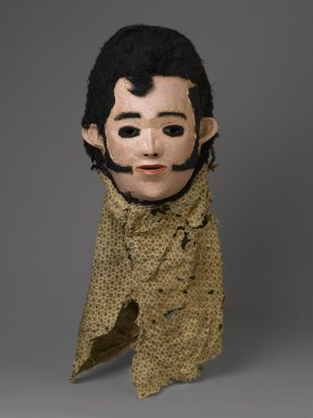 Chewa. 'Elvis' Mask for Nyau Society, ca. 1977. Wood, paint, fiber, cloth, 11 x 9 1/2 x 7 1/4 in. (27.9 x 24.1 x 18.4 cm). Brooklyn Museum, Gift of Mr. and Mrs. J. Gordon Douglas III, Frederick E. Ossorio, and Elliot Picket, by exchange and Designated Purchase Fund, 2010.41. Creative Commons-BY