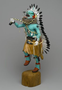 Orin Poley. Kachina Doll, 1960-1970. Cottonwood root, acrylic pigment, hide, feathers, shell, fur,  turquioise, metal, 17 3/4 x 6 x 9 in. (45.1 x 15.2 x 22.9 cm). Brooklyn Museum, Gift of Edith and Hershel Samuels, 2010.6.1. Creative Commons-BY