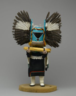Seona. Kachina Doll, 1960-1970. Cottonwood root, acrylic paint, feathers, sticks, yarn, canvas, cotton, fur, 15 x 9 x 4 1/2 in. (38.1 x 22.9 x 11.4 cm). Brooklyn Museum, Gift of Edith and Hershel Samuels, 2010.6.2. Creative Commons-BY
