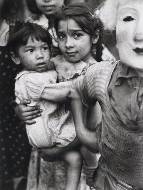 Nathan Lerner (American, 1914-1997). Child and Mask, 1936, printed later. Gelatin silver photograph, Mat: 24 x 19 3/4 in. (61 x 50.2 cm). Brooklyn Museum, Gift of Kiyoko Lerner, 2011.25.64. ©Nathan Lerner
