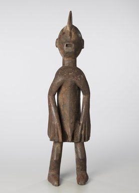 Chamba. Standing Male Figure, early 20th century. Wood, organic materials, 24 3/8 x 6 x 5 in. (61.9 x 15.2 x 12.7 cm). Brooklyn Museum, Gift in honor of William C. Siegmann in recognition of his contributions to the study and understanding of African Arts, 2011.31.1. Creative Commons-BY