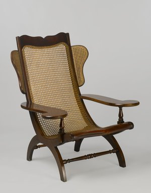 Easy Chair (Butaca), second quarter of the 19th century. Mahogany, cane, 43 x 35 3/4 x 35 3/8 in. (109.2 x 90.8 x 89.9 cm). Brooklyn Museum, Gift of Mrs. J. Fuller Feder, by exchange and Brooklyn Museum Collection, 2011.58.1. Creative Commons-BY