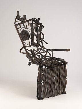 Gonçalo Mabunda (Mozambican, born 1975). Harmony Chair, 2009. Welded weapons (handguns, rifles, land mines, bullets, machine gun belts, rocket-propelled grenades), iron alloy, 48 1/16 x 38 3/16 x 29 15/16 in. (122.0 x 97.0 x 76.0 cm). Brooklyn Museum, Bequest of Samuel E. Haslett, by exchange, gift of Mrs. Morris Friedsam, Georgine Iselin, and Mrs. Joseph M. Schulte, by exchange and Designated Purchase Fund, 2013.26.2. © Gonçalo Mabunda