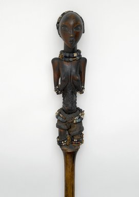 Luba. Ceremonial Staff (Kibango), 19th century. Wood, glass beads, cloth, fiber, iron, copper alloy, 59 x 3 3/4 x 3 7/8 in. (149.9 x 9.5 x 9.8 cm). Brooklyn Museum, Brooklyn Museum Collection, 22.1132. Creative Commons-BY