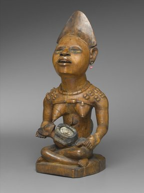 Kongo (Yombe subgroup). Figure of Mother and Child (Phemba), 19th century. Wood, beads, glass mirror, metal, resin, 11 x 5 x 4 1/2 in. (27.9 x 12.7 x 11.4 cm). Brooklyn Museum, Museum Expedition 1922, Robert B. Woodward Memorial Fund, 22.1138. Creative Commons-BY